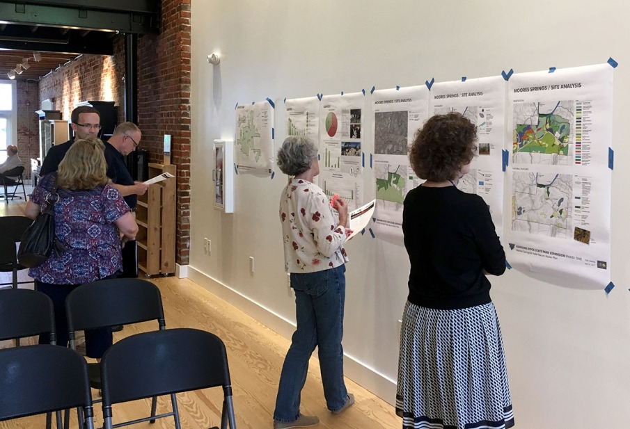 Community members look at maps at the first public meeting.